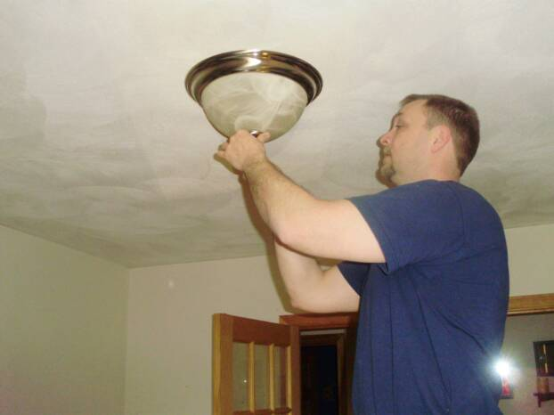 Massachusetts electricians installing lighting systems.